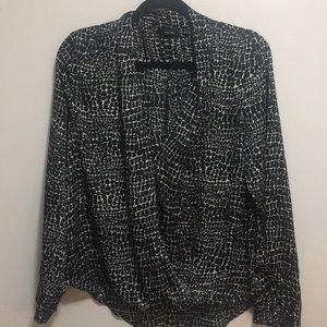 Black and white V-neck patterned blouse.